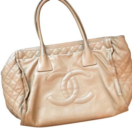 Preload https://img-static.tradesy.com/item/24044560/chanel-stitching-details-pocket-front-and-back-tan-leather-satchel-0-1-540-540.jpg
