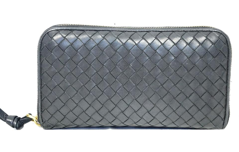 3c4a21e9c9aa2 Bottega Veneta Intrecciato Woven Dark Blue Leather Zip Around Wallet Image  0 ...