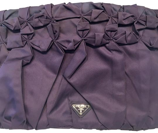 Preload https://img-static.tradesy.com/item/24049474/prada-oragami-purple-nylon-clutch-0-1-540-540.jpg