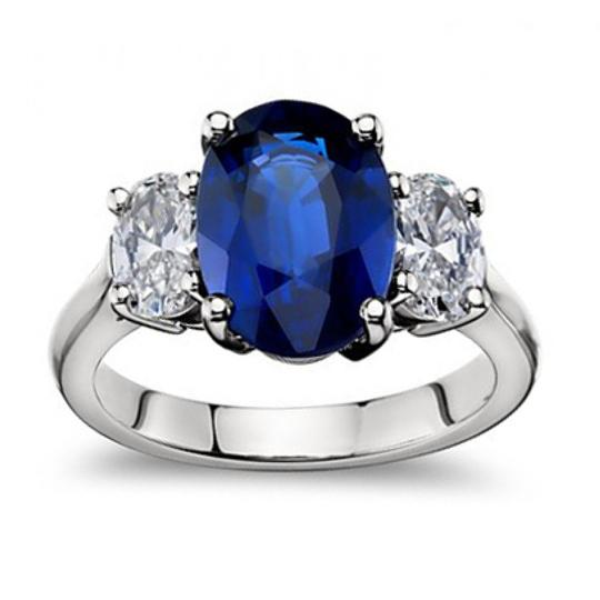 Preload https://item4.tradesy.com/images/madina-jewelry-white-945-ct-oval-shape-sapphire-with-oval-shape-diamond-anniversary-ring-24049643-0-0.jpg?width=440&height=440