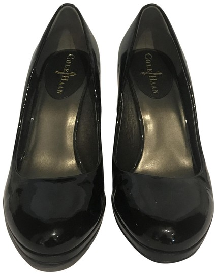 Preload https://img-static.tradesy.com/item/24049841/cole-haan-patent-black-wedges-size-us-75-regular-m-b-0-1-540-540.jpg