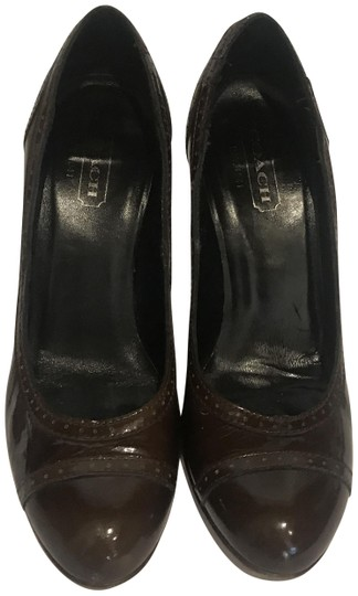 Preload https://item4.tradesy.com/images/coach-brown-patent-wing-tip-style-pumps-size-us-75-regular-m-b-24049888-0-1.jpg?width=440&height=440