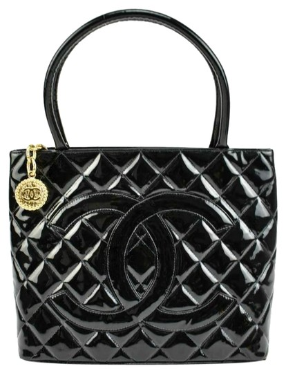 Preload https://item3.tradesy.com/images/chanel-black-quilted-patent-leather-and-cc-medallion-medium-mn-tote-24049942-0-1.jpg?width=440&height=440