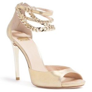 Marciano gold Pumps