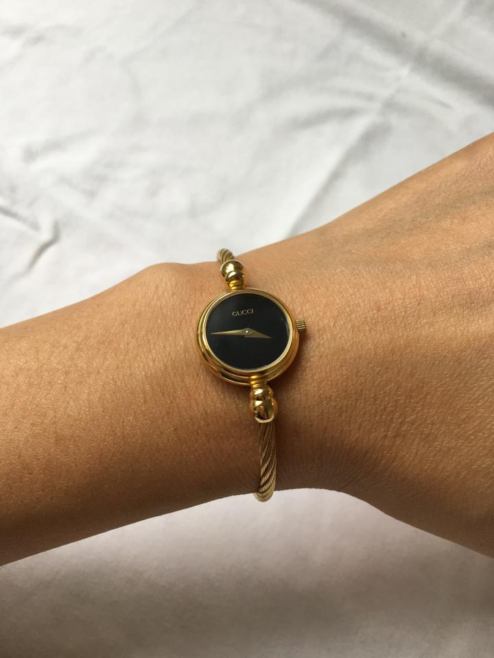 f1985414748 Gucci 18k Yellow Gold Plated  Black Face 2700l Quartz Cable Bangle Swiss  Made Watch - Tradesy