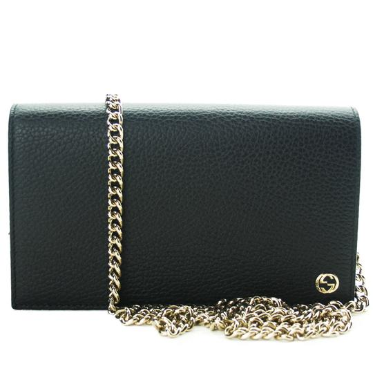 Preload https://img-static.tradesy.com/item/24062103/gucci-new-466506-gg-mini-chain-with-detachable-strap-black-leather-cross-body-bag-0-0-540-540.jpg