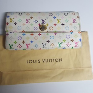 Louis Vuitton Louis Vuitton monogram multi color Merkami Sara wallet This wallet is in good/fair used condition with alot of life left. The canvas has signs of wear as well as the brass hardware with slight discoloration. You can see all the flaws in the pictures, but overall it really isn't bad at all. Date code TH2097 10 slots for credit cards 3 compartments for bills,and one for change. No rips, or odors comes with dust cover.