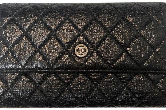 Preload https://img-static.tradesy.com/item/24074580/chanel-black-leather-wallet-0-1-540-540.jpg