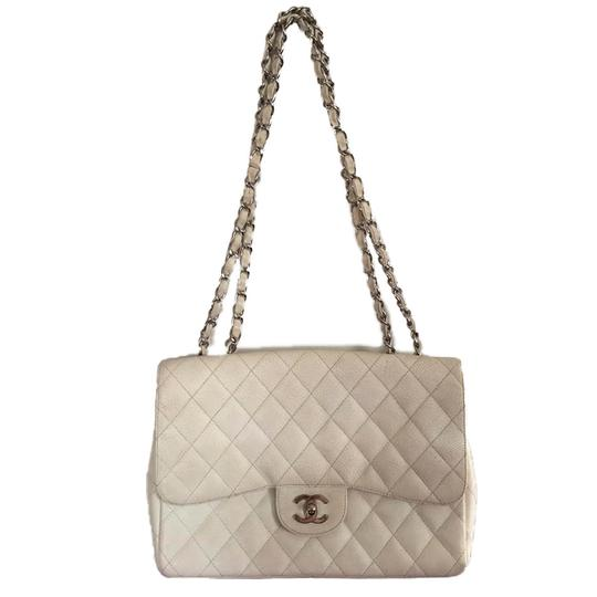 Preload https://img-static.tradesy.com/item/24074712/chanel-classic-flap-10617489-white-quilted-caviar-leather-shoulder-bag-0-0-540-540.jpg