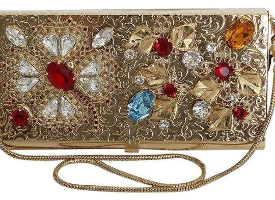 Preload https://img-static.tradesy.com/item/24074789/dolce-and-gabbana-d30203-1-women-s-one-size-gold-30-crystal-70-brass-clutch-0-1-540-540.jpg