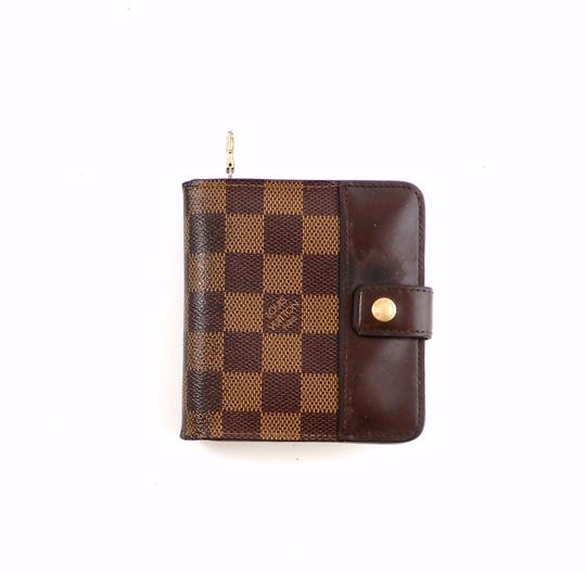 Preload https://img-static.tradesy.com/item/24075032/louis-vuitton-brown-damier-canvas-leather-bifold-compact-zippy-snap-spain-wallet-0-0-540-540.jpg