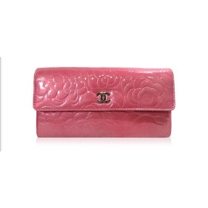 Chanel Chanel pink camellia patent wallet.