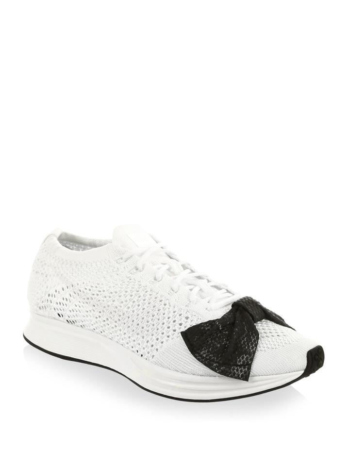 5fbd97df2c82 COMME des GARÇONS x Nike White and Black The Flyknit Racer Sneakers. Size   US 7.5 ...