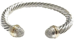 David Yurman David Yurman Pavé Diamond Two Tone Classic Cable Bracelet Sterling silver and 18k yellow gold Beautiful pavé style diamonds at both ends of bangle with 18k yellow gold bands Small, 7mm 100% Authentic Guaranteed Comes inside original David Yurman pouch!