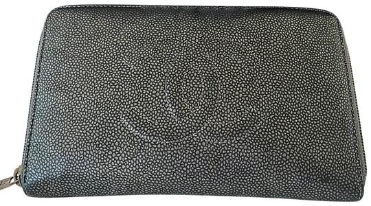 Preload https://img-static.tradesy.com/item/24096829/chanel-black-and-silver-large-zipped-leather-wallet-0-1-540-540.jpg