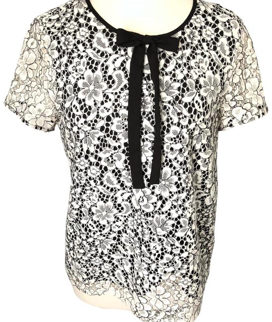 Preload https://img-static.tradesy.com/item/24097414/karl-lagerfeld-floral-lace-bowtie-blouse-size-8-m-0-3-650-650.jpg