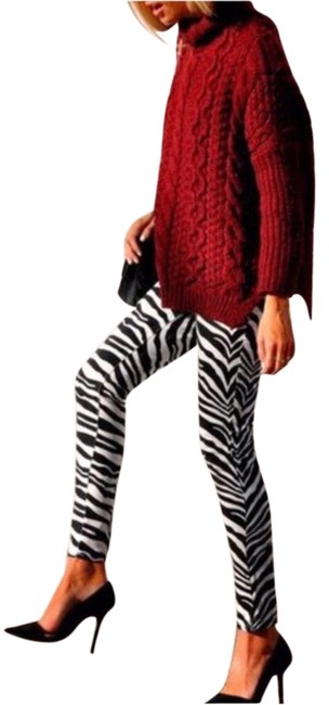 Preload https://img-static.tradesy.com/item/24097680/black-and-white-animal-print-leggings-size-os-one-size-0-1-650-650.jpg