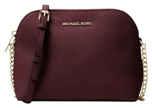 9bc525c42e02 Added to Shopping Bag. Michael Kors Cross Body Bag. Michael Kors Cindy  Large Dome Damson Gold Saffiano Leather ...