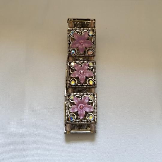Preload https://img-static.tradesy.com/item/24099457/swarovski-pink-enamel-and-crystal-s-flower-bracelet-0-3-540-540.jpg