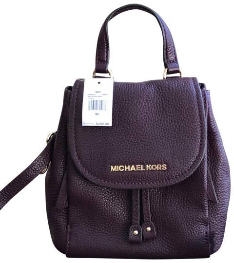Preload https://img-static.tradesy.com/item/24099671/michael-kors-riley-small-flap-pack-handbag-damson-pebbled-leather-cross-body-bag-0-1-540-540.jpg