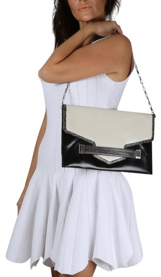 Preload https://img-static.tradesy.com/item/24100698/rafe-chain-strap-clutch-black-and-white-patent-leather-shoulder-bag-0-1-540-540.jpg