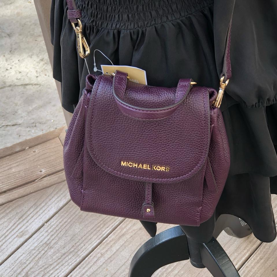 47a204597ba4 Michael Kors Riley Small Flap Pack Handbag Damson Pebbled Leather Cross  Body Bag - Tradesy