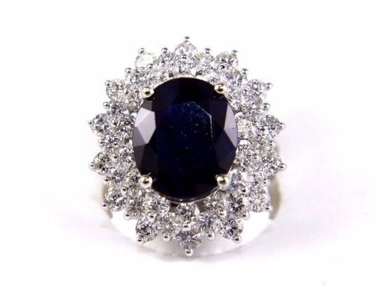 Preload https://img-static.tradesy.com/item/24102089/blue-and-silver-oval-cut-sapphire-cocktail-wdiamond-halo-14k-wg-988ct-ring-0-0-540-540.jpg