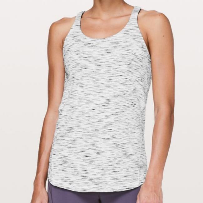 Lululemon NWT lululemon moment to Movement 2 in 1 tank size 10 tiger space dye