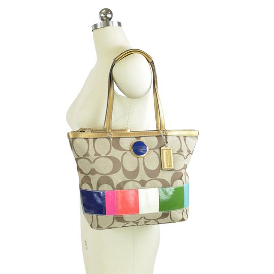 Preload https://img-static.tradesy.com/item/24106419/coach-limited-edition-stripe-shopper-lunch-15588-khaki-multi-signature-fabric-tote-0-2-540-540.jpg