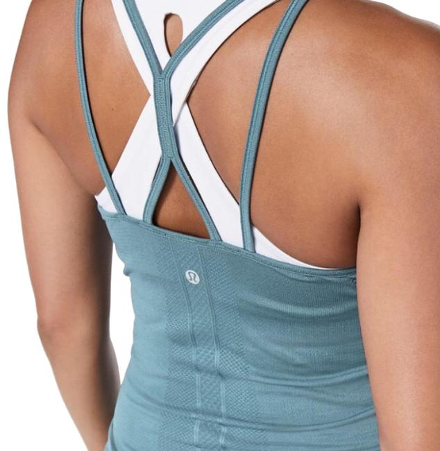 Preload https://img-static.tradesy.com/item/24106720/lululemon-slate-blue-swiftly-tech-strappy-activewear-top-size-10-m-0-1-650-650.jpg
