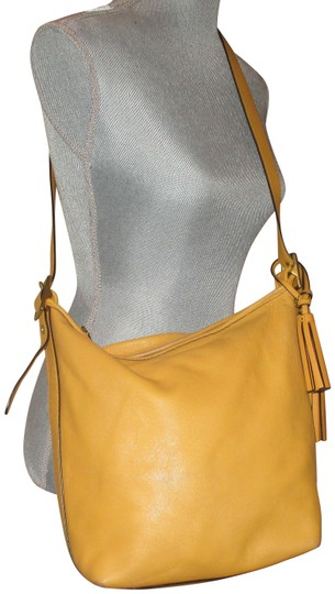 Preload https://img-static.tradesy.com/item/24106804/coach-legacy-duffel-convertible-19889-mustard-yellow-leather-shoulder-bag-0-1-540-540.jpg