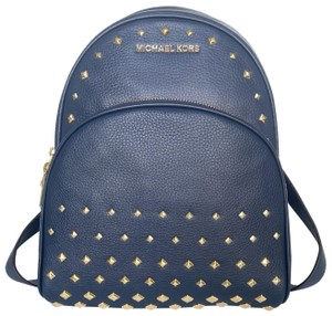 9bc5ff19d Michael Kors Backpack · Michael Kors. Pebbled Abbey Medium Studded Navy Leather  Backpack