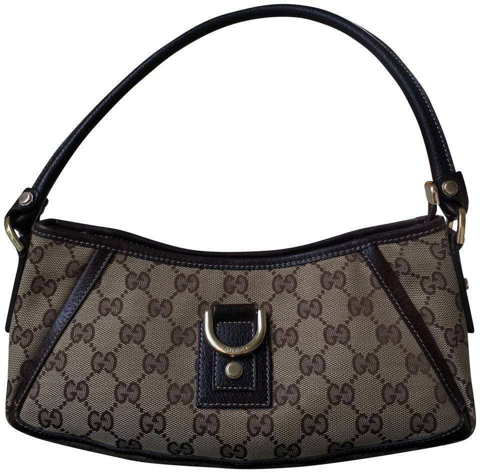 93228c7d00f Gucci Abbey Monogram D Ring Pochette Brown   Dark Brown Gg Canvas ...