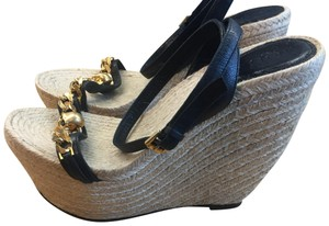 Alexander McQueen black and gold Wedges