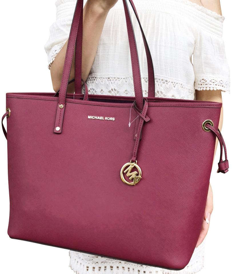 9addcf7da2dc Michael Kors Jet Set Drawstring Leather Pouch Tote in Mulberry Image 0 ...
