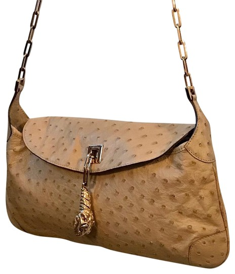 Preload https://img-static.tradesy.com/item/24125840/gucci-tiger-head-tan-ostrich-leather-baguette-0-15-540-540.jpg