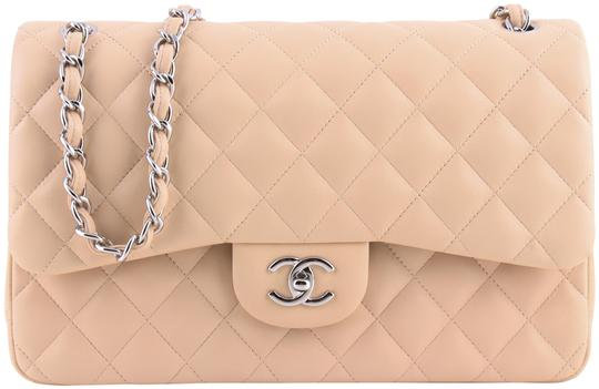 Preload https://img-static.tradesy.com/item/24126416/chanel-jumbo-quilted-classic-double-flap-beige-lambskin-leather-shoulder-bag-0-1-540-540.jpg