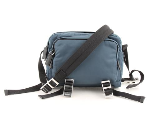 Preload https://img-static.tradesy.com/item/24126526/prada-teal-technical-fabric-blue-nylon-cross-body-bag-0-0-540-540.jpg