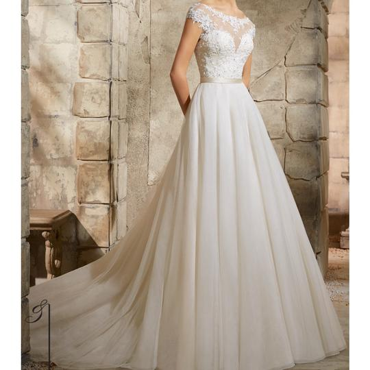 Preload https://img-static.tradesy.com/item/24129369/mori-lee-ivory-lace-and-soft-tulle-5362-feminine-wedding-dress-size-8-m-0-0-540-540.jpg