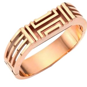 Tory Burch Tory Burch Gold bracelet for Fitbit. Metal Hinge Bangle Bracelet