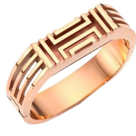 Preload https://img-static.tradesy.com/item/24129946/tory-burch-gold-bracelet-for-fitbit-metal-hinge-bangle-bracelet-tech-accessory-0-0-540-540.jpg