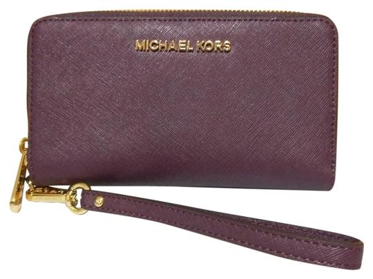 Preload https://img-static.tradesy.com/item/24132303/michael-kors-purple-jet-set-large-flat-mf-phone-case-wristlet-fulton-wallet-0-1-540-540.jpg