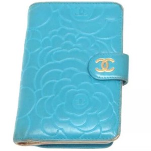 Chanel CHANEL Turquoise Leather Camellia Embossed L Zip Pocket Wallet