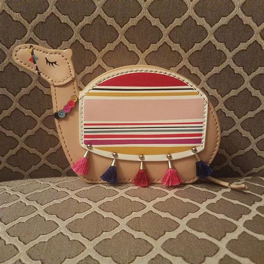Preload https://img-static.tradesy.com/item/24136783/kate-spade-spice-things-up-camel-coin-purse-wallet-0-0-540-540.jpg