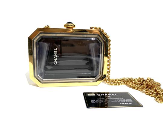 Preload https://img-static.tradesy.com/item/24137010/chanel-minaudiere-limited-edition-premiere-watch-gold-tone-hardwar-black-plexiglass-cross-body-bag-0-0-540-540.jpg