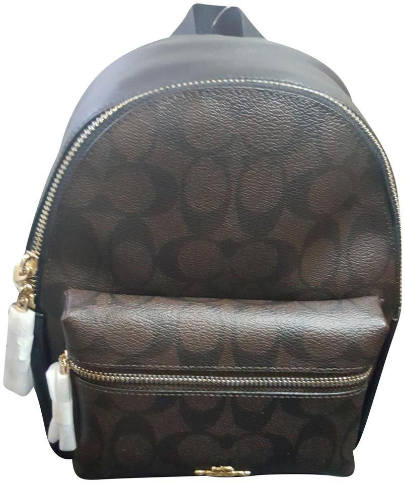 91ab24101 Coach Mini Charlie Bookbag Black/Brown Coated Canvas Backpack - Tradesy