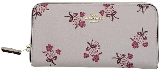 Preload https://img-static.tradesy.com/item/24143511/coach-accordion-zip-with-floral-bow-print-wallet-0-1-540-540.jpg