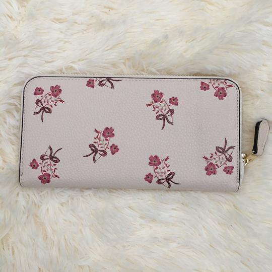 Coach accordion zip wallet with floral bow print Image 1