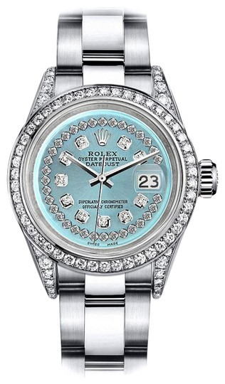 Preload https://img-static.tradesy.com/item/24146354/rolex-stainless-steel-turquoise-string-26mm-datejust-diamonds-bezel-and-lugs-oyster-watch-0-1-540-540.jpg