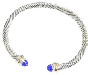 "David Yurman David Yurman Never Worn Lapis Lazuli 14k and Sterling Silver Cable Bangle 14k Yellow Gold and Sterling Silver Beautiful lapis lazuli at each end of the bracelet 5mm Medium 7.25"" 100% Authentic Guaranteed Comes inside original David Yurman pouch!"